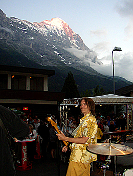 Charlie Morris on stage in Grindelwald, with the Eiger in the background
